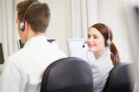 sale - Business people working in headsets Stock Photo - Premium Royalty-Free, Code: 649-06041250