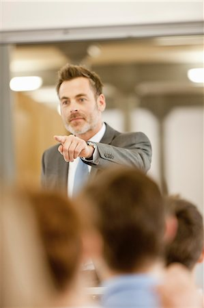 Businessman hosting seminar in office Stock Photo - Premium Royalty-Free, Code: 649-06041263