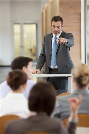 Businessman hosting seminar in office Stock Photo - Premium Royalty-Free, Code: 649-06041271