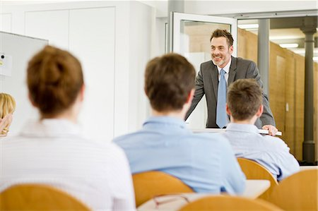 Businessman hosting seminar in office Stock Photo - Premium Royalty-Free, Code: 649-06041291