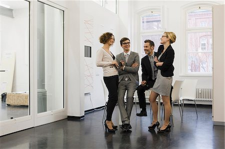 Business people talking in office Stock Photo - Premium Royalty-Free, Code: 649-06041304