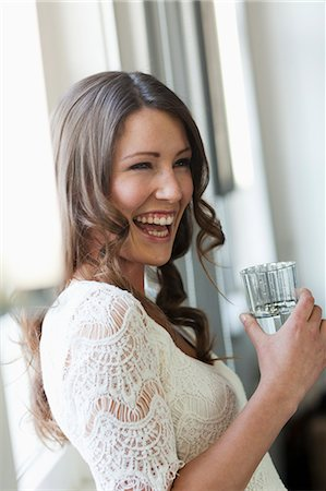 Smiling woman drinking glass of water Stock Photo - Premium Royalty-Free, Code: 649-06041353