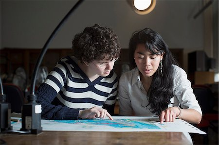 Students reading map in class Stock Photo - Premium Royalty-Free, Code: 649-06041393