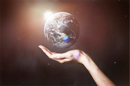 Hand holding image of the Earth Stock Photo - Premium Royalty-Free, Code: 649-06041473
