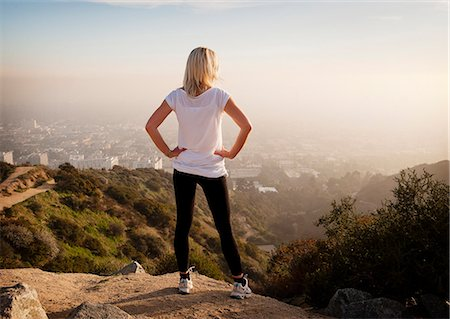 Woman overlooking view from hilltop Stock Photo - Premium Royalty-Free, Code: 649-06041485