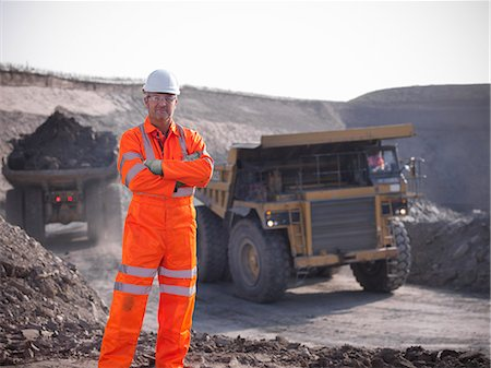 people working coal mines - Worker standing at coal mine Stock Photo - Premium Royalty-Free, Code: 649-06041502