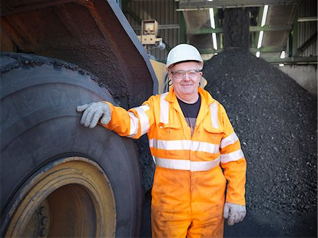 piles of work - Worker standing by truck at coal mine Stock Photo - Premium Royalty-Free, Code: 649-06041518