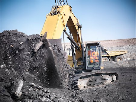 people working coal mines - Digger scooping coal at mine Stock Photo - Premium Royalty-Free, Code: 649-06041510