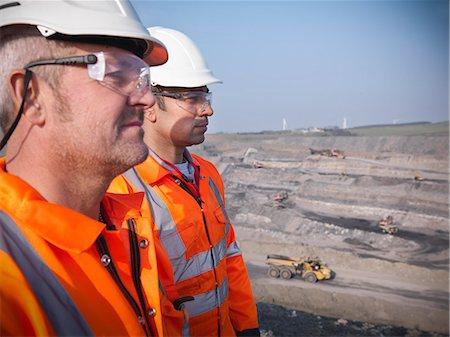 Workers overlooking coal mine Stock Photo - Premium Royalty-Free, Code: 649-06041527