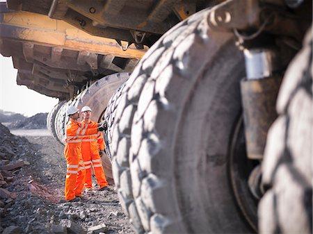 Workers examining trucks in coal mine Stock Photo - Premium Royalty-Free, Code: 649-06041530