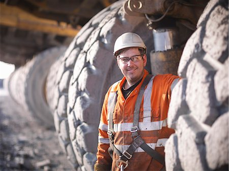 Worker standing by trucks in coal mine Stock Photo - Premium Royalty-Free, Code: 649-06041532