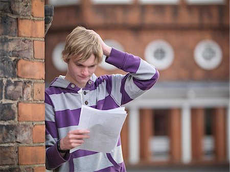 Upset student reading grades at school Stock Photo - Premium Royalty-Free, Code: 649-06041610