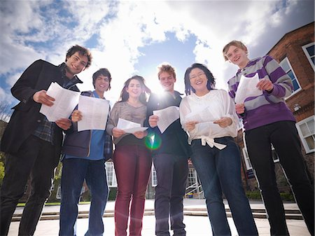 Students reading grades together Stock Photo - Premium Royalty-Free, Code: 649-06041611