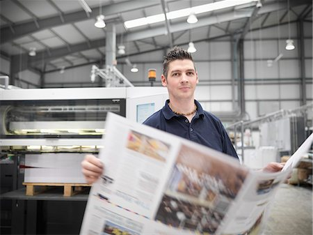 print - Worker with paper in printers shop Stock Photo - Premium Royalty-Free, Code: 649-06041613