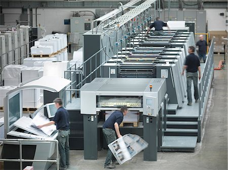 print - Workers running printing press Stock Photo - Premium Royalty-Free, Code: 649-06041636