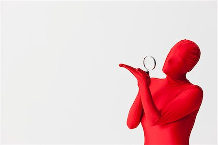 Woman in bodysuit with magnifying glass Stock Photo - Premium Royalty-Free, Code: 649-06041647
