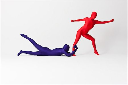 Couple in bodysuits posing together Stock Photo - Premium Royalty-Free, Code: 649-06041668
