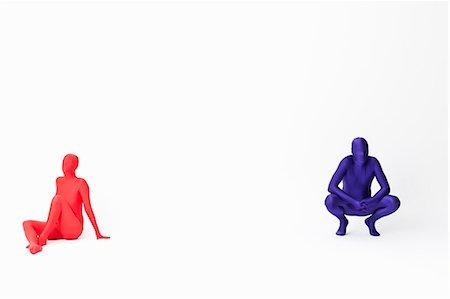 Couple in bodysuits sitting on floor Stock Photo - Premium Royalty-Free, Code: 649-06041677