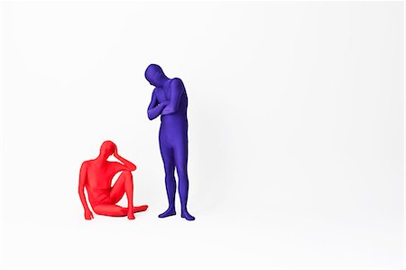Couple in bodysuits arguing Stock Photo - Premium Royalty-Free, Code: 649-06041673