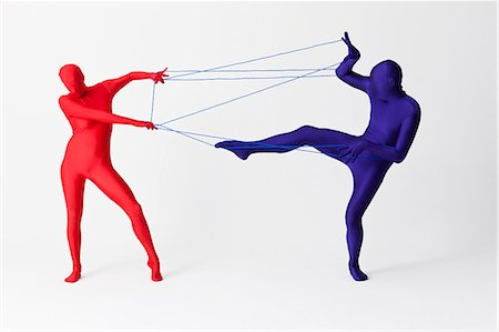Couple in bodysuits playing with string Stock Photo - Premium Royalty-Free, Code: 649-06041686