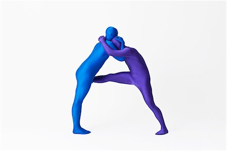 flexible (people or objects with physical bendability) - Men in bodysuits making the letter A Stock Photo - Premium Royalty-Free, Code: 649-06041709