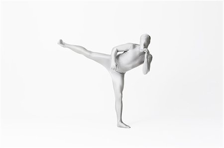 flexible (people or objects with physical bendability) - Man in bodysuit posing Stock Photo - Premium Royalty-Free, Code: 649-06041701