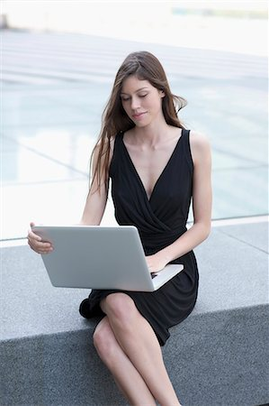 Businesswoman using laptop outdoors Stock Photo - Premium Royalty-Free, Code: 649-06041750