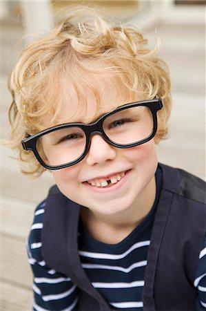 Smiling boy wearing glasses outdoors Stock Photo - Premium Royalty-Free, Code: 649-06041772