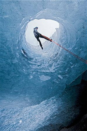 Climber abseiling into ice cave Stock Photo - Premium Royalty-Free, Code: 649-06041878
