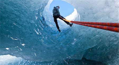 Climber abseiling into ice cave Stock Photo - Premium Royalty-Free, Code: 649-06041887