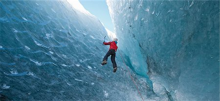 Climber climbing out of ice cave Stock Photo - Premium Royalty-Free, Code: 649-06041882