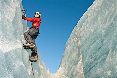 Climber scaling glacier wall Stock Photo - Premium Royalty-Free, Code: 649-06041896