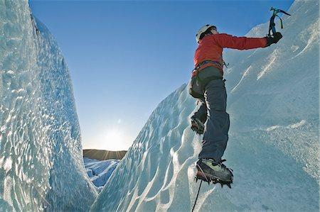 Climber scaling glacier wall Stock Photo - Premium Royalty-Free, Code: 649-06041897