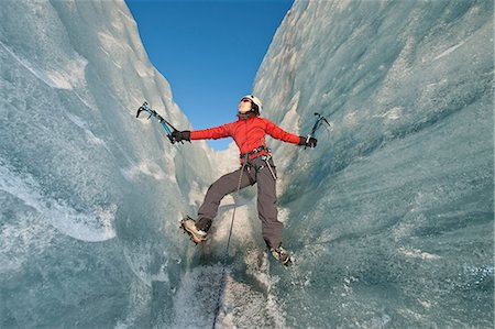 Climber scaling glacier wall Stock Photo - Premium Royalty-Free, Code: 649-06041898