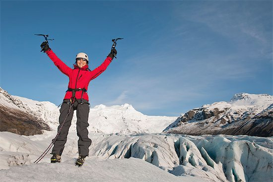 Climber cheering on top of glacier Stock Photo - Premium Royalty-Free, Image code: 649-06041890