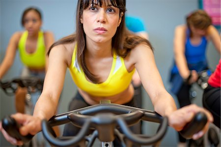 fitness older women gym - People using spin machines in gym Stock Photo - Premium Royalty-Free, Code: 649-06041964