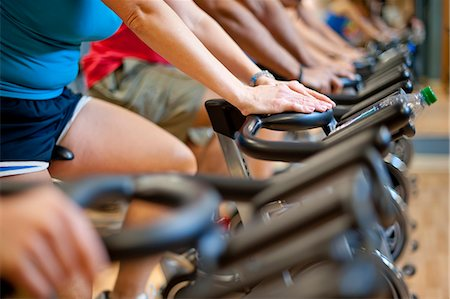 property release - People using spin machines in gym Stock Photo - Premium Royalty-Free, Code: 649-06041968