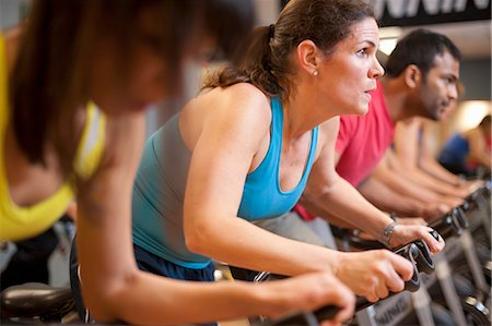 fitness older women gym - People using spin machines in gym Stock Photo - Premium Royalty-Free, Code: 649-06041970