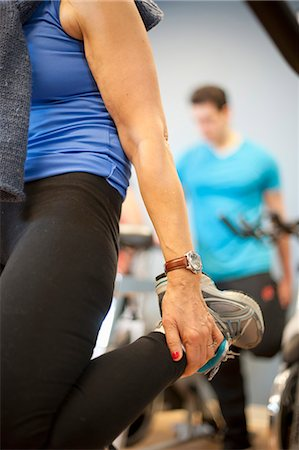 fitness older women gym - Close up of woman stretching in gym Stock Photo - Premium Royalty-Free, Code: 649-06041999