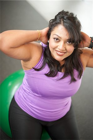 fat lady sitting - Woman using exercise ball in gym Stock Photo - Premium Royalty-Free, Code: 649-06042008
