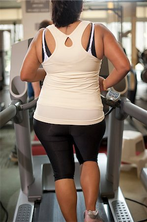 Woman using treadmill in gym Stock Photo - Premium Royalty-Free, Code: 649-06042034
