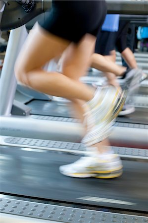 fitness   mature woman - Blurred view of people on treadmills Stock Photo - Premium Royalty-Free, Code: 649-06042030