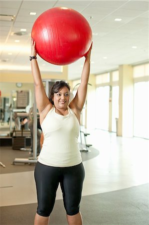 Woman using exercise ball in gym Stock Photo - Premium Royalty-Free, Code: 649-06042040