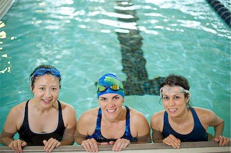 Women at edge of swimming pool Stock Photo - Premium Royalty-Free, Code: 649-06042074