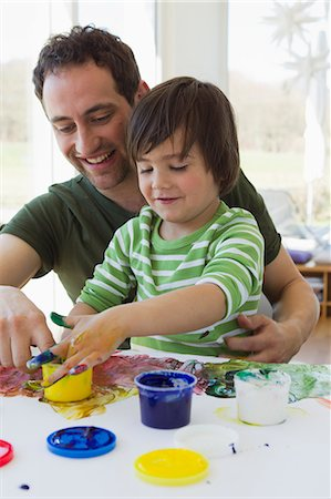 domestic life - Father and son finger painting together Stock Photo - Premium Royalty-Free, Code: 649-06112566