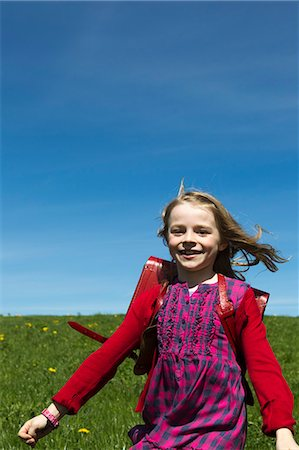 Smiling girl wearing backpack outdoors Stock Photo - Premium Royalty-Free, Code: 649-06112583