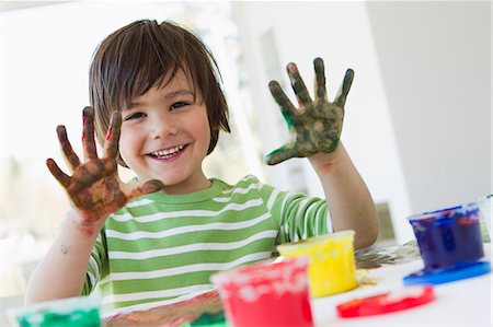finger painting - Smiling boy finger painting indoors Stock Photo - Premium Royalty-Free, Code: 649-06112599