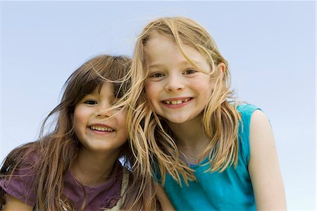 Girls smiling together outdoors Stock Photo - Premium Royalty-Free, Code: 649-06112621