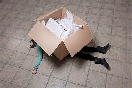 people falling - Teenage girl lying under cardboard box Stock Photo - Premium Royalty-Free, Code: 649-06112659