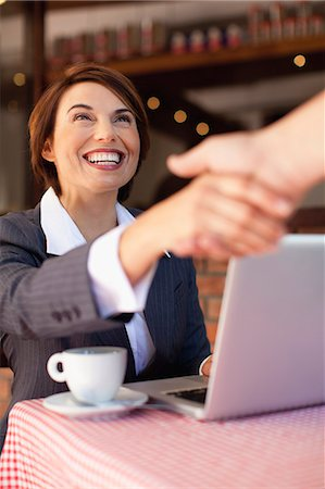 Business people shaking hands in cafe Stock Photo - Premium Royalty-Free, Code: 649-06112754
